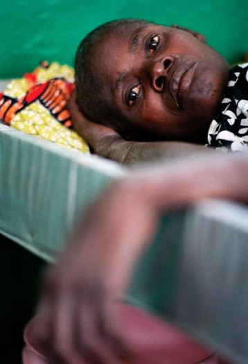 A man receives treatment for cholera in the CTC. The Cholera Treatment Centre (CTC) was established by the IRC. Kate Holt.