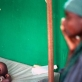 A young child with cholera is watched by his mother. Kate Holt.