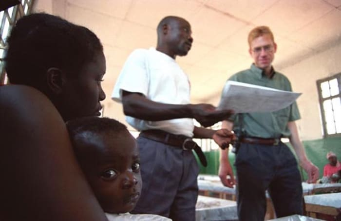 Nigel, a doctor employed by IRC, and Jonas, a local nurse employed by IRC, discuss the progress. Kate Holt.