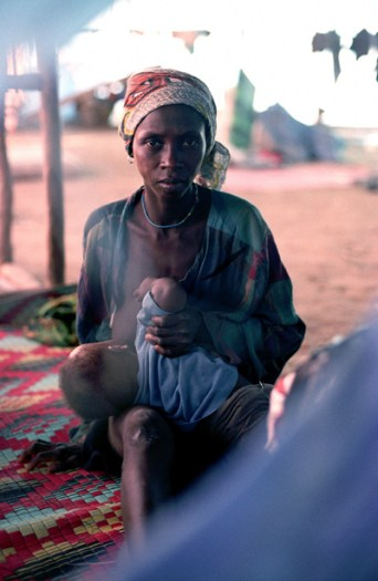 A woman and her child who have been displaced by renewed fighting on the outskirts of Monrovia. Kate Holt.