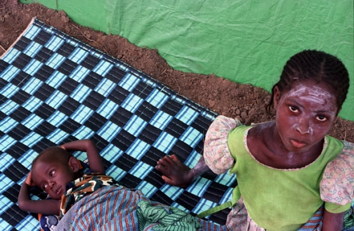This young girl and her baby brother were orphaned when their village came under rebel attack. Kate Holt.