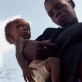A mother from Cote D'Ivoire with her young child. Having travelled for over three weeks to reach Saclapea camp. Kate Holt.