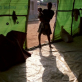 A girl and her young baby stand in the doorway of an IDP settlement in Monrovia. Kate Holt.