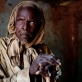 Sila Maigari, who lost his sight to river blindess forty years ago, poses for a photograph. Kate Holt.