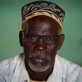 Abdi Saman, A community leader who advocates against FGM, poses for a photograph at a community meeting. Kate Holt.