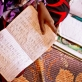 Sarah Mowlid Mohammed does her homework at her home  in the Shabelle IDP settlement in  Garowe, Somalia Tuesday. Kate Holt.