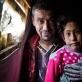 Firaz Hilal, who has four children and is from Homs, poses for a photograph with his daughter Aya. Kate Holt.