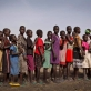 Young girls queue up to be registered for school at an emergency food distribution site. Kate Holt.