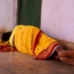 A woman sleeps on the floor in Kolibera health centre near to Ranchi, India Friday, May 30, 2014. Kate Holt.