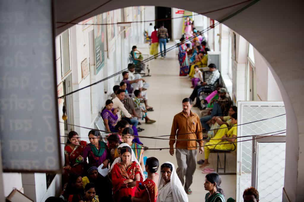 Women sit in the women's hospital after delivering their babies in the hospital in Ranchi. Kate Holt.