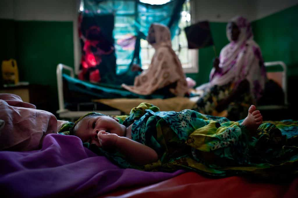 A newborn baby lies in the maternity unit of Benadir Hospital in Mogadishu. Many women undergo severe problems in child birth. Kate Holt.