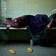 A woman sleeps in a female ward in Benadir Hospital. Many women undergo severe problems in child birth. Kate Holt.