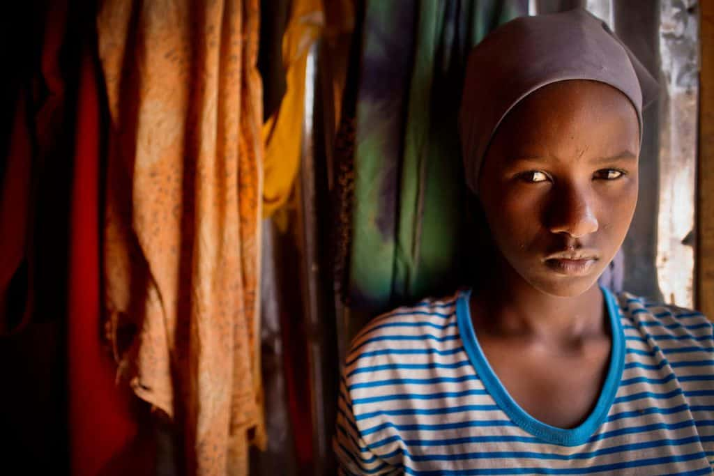 A young girl poses for a photograph in the Shabelle IDP settlement in Garowe, Somalia Tuesday, July 1, 2014. Kate Holt.