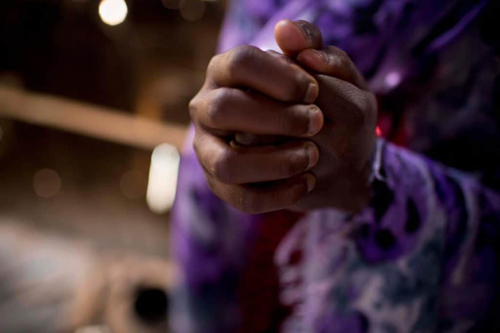 Sarah Mowlid Mohammed grips her hands tight as she tells her story at her home in the Shabelle IDP settlement in Garowe. Kate Holt.