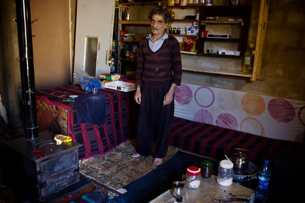 Mohammad Raabah, 71 years old and from eastern Damascus, and who has lived in this disused building for over two years. Kate Holt.