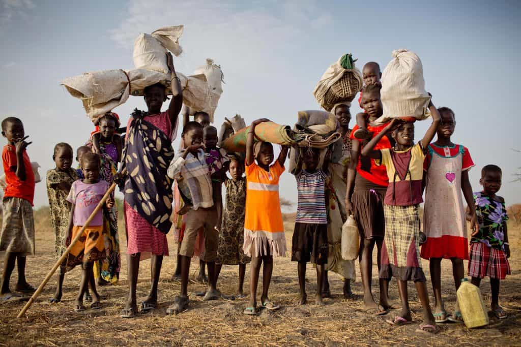 Families who have been displaced by ongoing fighting in South Sudan arrive with what few possessions they have. Kate Holt.