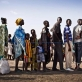 Families who have been displaced by ongoing fighting inSouth Sudanwait to register to receive a ration card. Kate Holt.