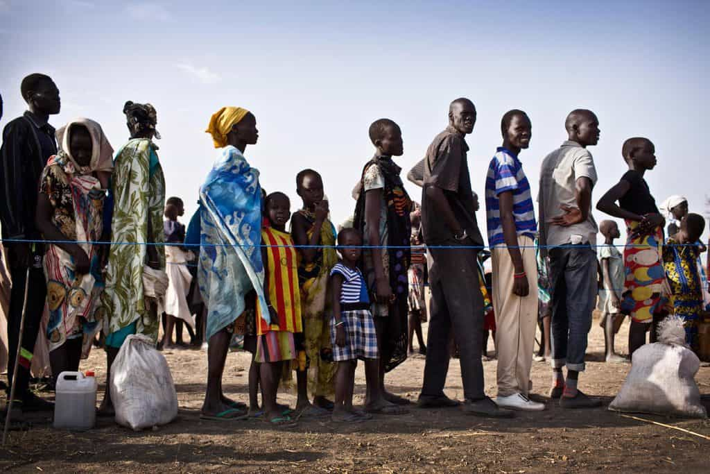 Families who have been displaced by ongoing fighting in South Sudan wait to register to receive a ration card. Kate Holt.