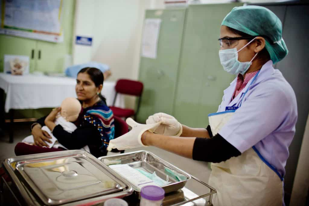 A trainee nurse who attends the nursing college that receives technical support from MCHIP does a demonstration. Kate Holt.