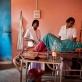 Agatha Kiro, a staff nurse who has undergone MCHIP training, helps a women to deliver a baby. Kate Holt.