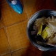 A bucket, containing rubber gloves and sharp materials  at the Grey Bush Community Health Centre in Freetown. Kate Holt.