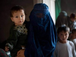 Families who have been displaced be recent fighting in Uruzgan between Afghan Government soldiers and the Taliban, pose for photographs in a house that is still being built where four families are currently living in Kandahar, Afghanistan Sunday, Sept. 25, 2016. Thousands of families were forced to flee Tarin Kot, the capital of Uruzgan province, in September when the town was attacked by the Taliban in days of fierce fighting.