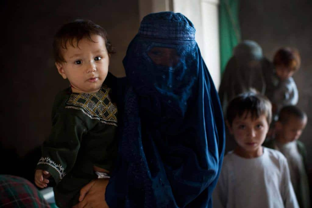 This family is one of thousands forced to flee Uruzgan after the Taliban attacked the province's capital, Tarin Kot, in September, resulting in fierce fighting with Afghan government troops. They are living with three other families in a house in Kandahar that is still under construction. Kate Holt.