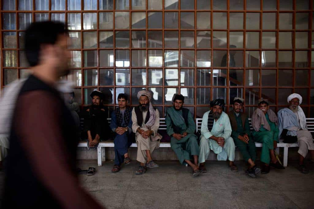 Men wait in the hallway of Mirwais Hospital,  Kandahar.