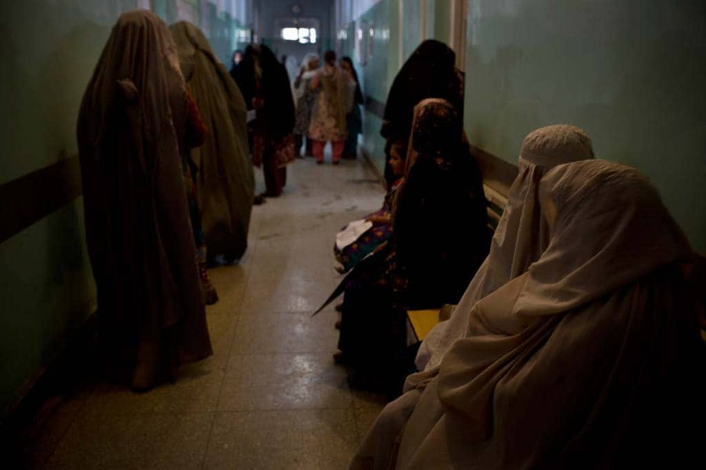 Women wait to see a doctor in the Obstetrics unit of Mirwais Hospital,  Kandahar, Afghanistan Monday, Sept. 26, 2016.  Afghanistan's government is struggling to contain a resilient Taliban insurgency amid protacted wrangling among politicians in Kabul. Civilians are paying an increasingly heavy price for the conflict, with many unable to access basic healthcare.