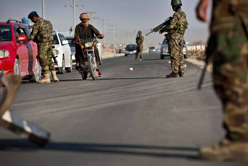 Afghan army soldiers man a checkpoint on the outskirts of Kandahar. Kate Holt.
