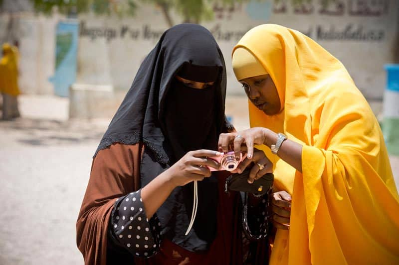 Teachers, who have attended the Photoclub training run by UNICEF and Arete, teach their pupils how to take photographs at Daawiish School in Garowe, Somalia Wednesday, April 30, 2014. (Kate Holt/ UNICEF Photo/)